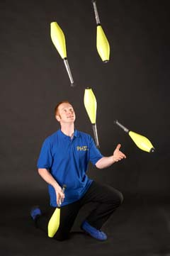 Image of Mr Phil practising 5 club juggling