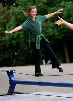 Girl successfullu balancing on a tightwire