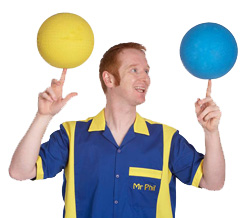 Mr Phil demonstrates how to spin two balls at a circus workshop in Plymouth