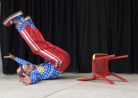 Spangles the Clown shows off his circus skills and falls over!